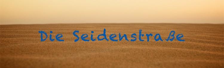 Nahaufnahme von Wüstensand mit Schriftzug